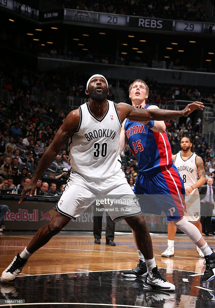 Reggie Evans #30 of the Brooklyn Nets positions himself against Kyle Singler #25 of the Detroit Pistons on April 17, 2013 at the Barclays Center in the Brooklyn borough of New York City.