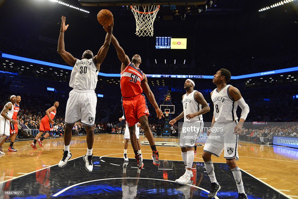 <a gi-track='captionPersonalityLinkClicked' href=/galleries/search?phrase=Reggie+Evans&family=editorial&specificpeople=202254 ng-click='$event.stopPropagation()'>Reggie Evans</a> #30 of the Brooklyn Nets reaches for a rebound against <a gi-track='captionPersonalityLinkClicked' href=/galleries/search?phrase=Emeka+Okafor&family=editorial&specificpeople=201739 ng-click='$event.stopPropagation()'>Emeka Okafor</a> #50 of the Washington Wizards on March 8, 2013 at the Barclays Center in Brooklyn, New York.