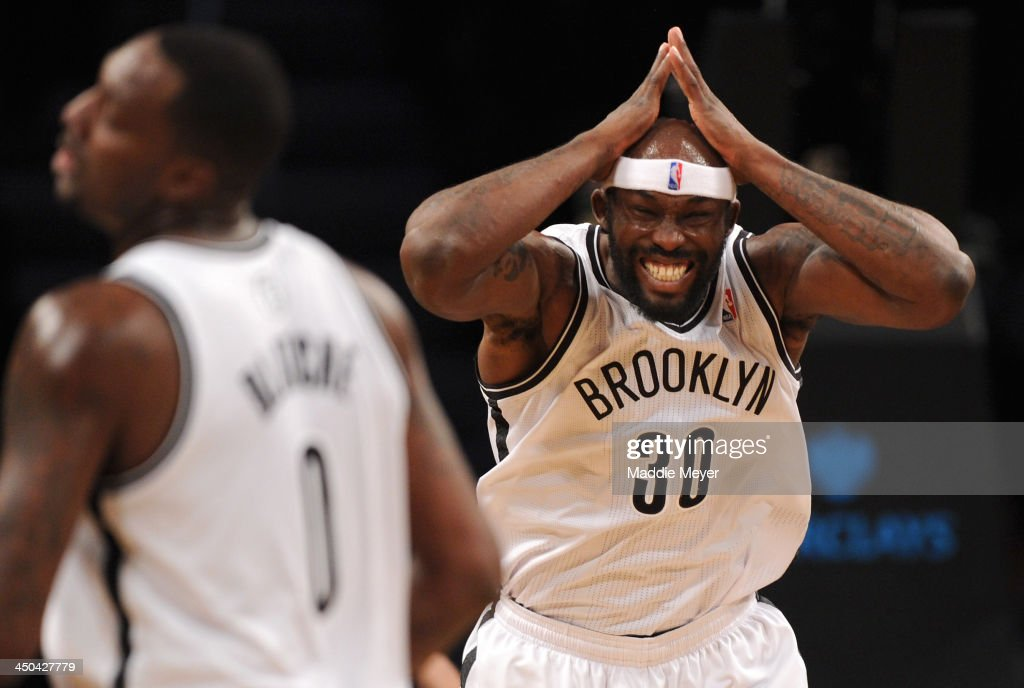 Reggie Evans #30 of the Brooklyn Nets reacts after missing a shot against the Portland Trail Blazers during the second quarter at Barclays Center on November 18, 2013 in the Brooklyn borough of New York City.