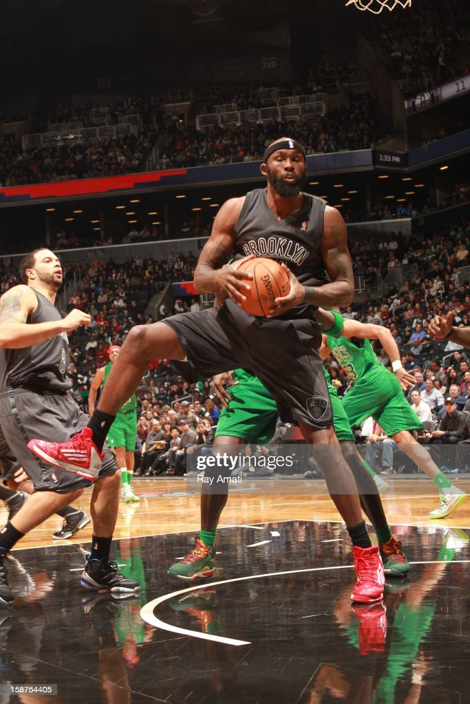 <a gi-track='captionPersonalityLinkClicked' href=/galleries/search?phrase=Reggie+Evans&family=editorial&specificpeople=202254 ng-click='$event.stopPropagation()'>Reggie Evans</a> #30 of the Brooklyn Nets rebounds against the Boston Celtics on December 25, 2012 at the Barclays Center in Brooklyn, New York.