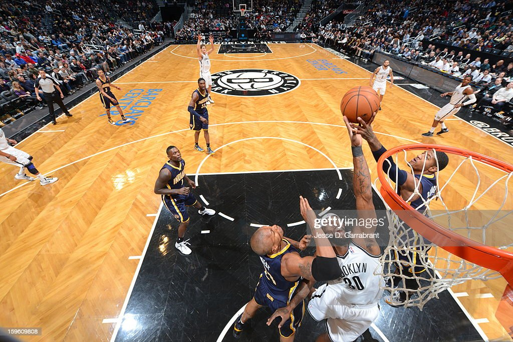 Reggie Evans #30 of the Brooklyn Nets rebounds against the Indiana Pacers during the game at the Barclays Center on January 13, 2013 in Brooklyn, New York.