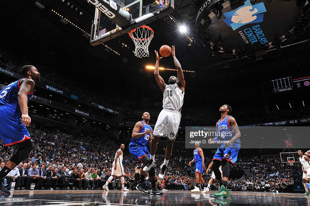 <a gi-track='captionPersonalityLinkClicked' href=/galleries/search?phrase=Reggie+Evans&family=editorial&specificpeople=202254 ng-click='$event.stopPropagation()'>Reggie Evans</a> #30 of the Brooklyn Nets rebounds against the Philadelphia 76ers on April 9, 2013 at the Barclays Center in Brooklyn, New York.