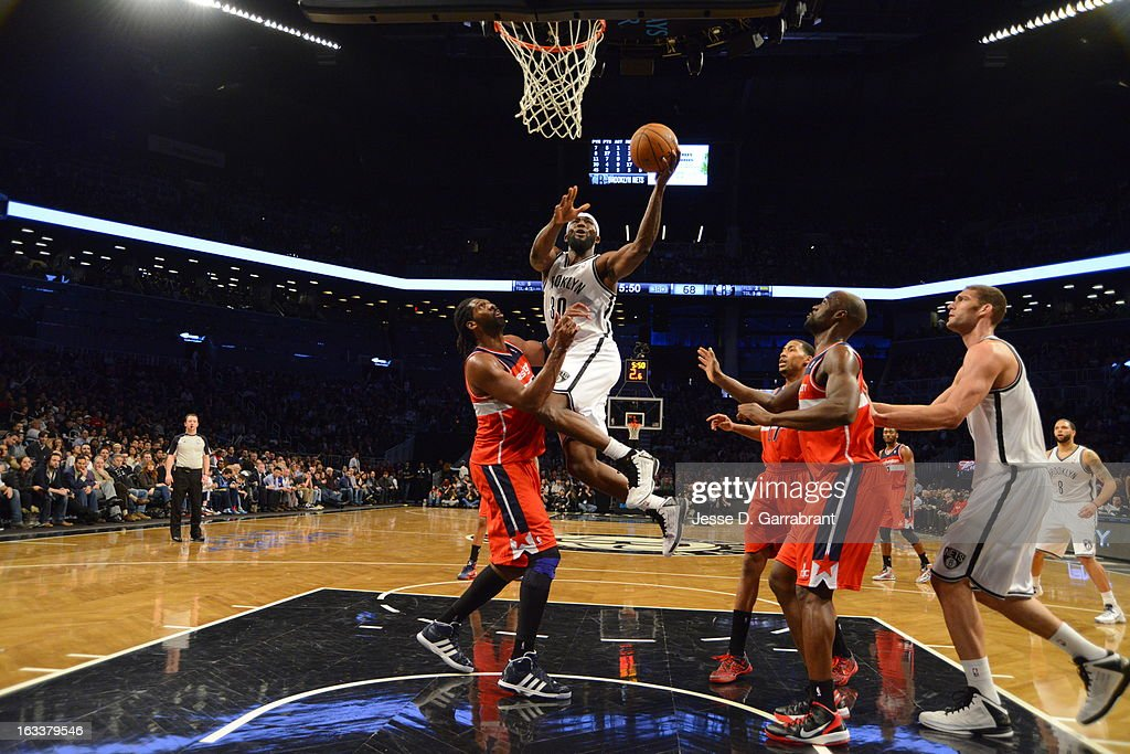 <a gi-track='captionPersonalityLinkClicked' href=/galleries/search?phrase=Reggie+Evans&family=editorial&specificpeople=202254 ng-click='$event.stopPropagation()'>Reggie Evans</a> #30 of the Brooklyn Nets shoots a driving layup against Nene #42 of the Washington Wizards on March 8, 2013 at the Barclays Center in Brooklyn, New York.
