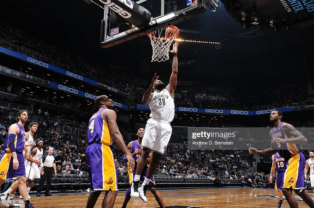 Reggie Evans #30 of the Brooklyn Nets shoots a layup against Antawn Jamison #4 of the Los Angeles Lakers on February 5, 2013 at the Barclays Center in the Brooklyn borough of New York City.