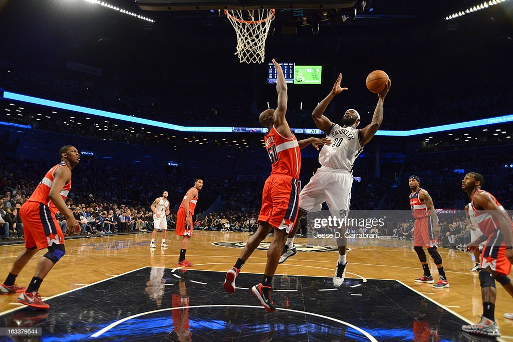 <a gi-track='captionPersonalityLinkClicked' href=/galleries/search?phrase=Reggie+Evans&family=editorial&specificpeople=202254 ng-click='$event.stopPropagation()'>Reggie Evans</a> #30 of the Brooklyn Nets shoots a layup against <a gi-track='captionPersonalityLinkClicked' href=/galleries/search?phrase=Emeka+Okafor&family=editorial&specificpeople=201739 ng-click='$event.stopPropagation()'>Emeka Okafor</a> #50 of the Washington Wizards on March 8, 2013 at the Barclays Center in Brooklyn, New York.