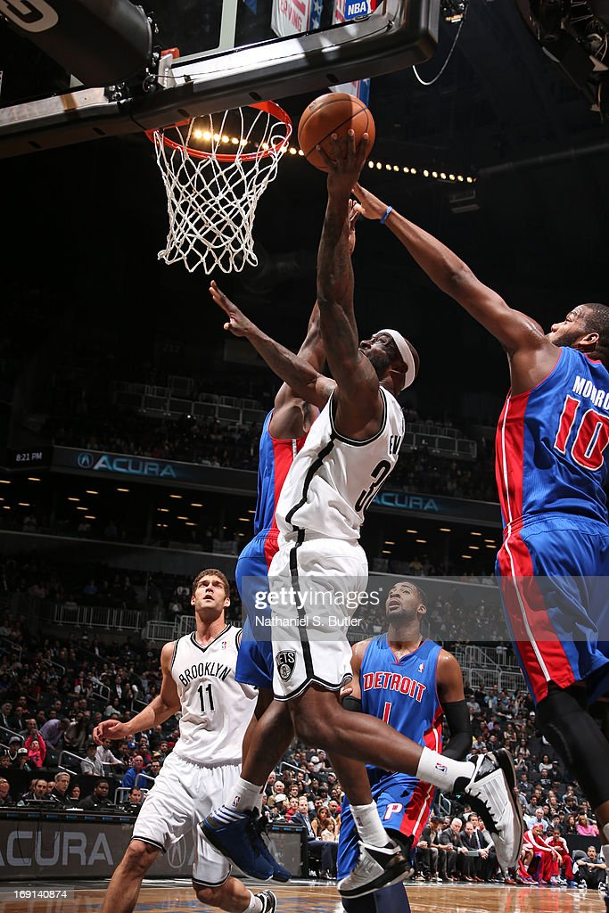 Reggie Evans #30 of the Brooklyn Nets shoots a layup against Greg Monroe #10 of the Detroit Pistons on April 17, 2013 at the Barclays Center in the Brooklyn borough of New York City.