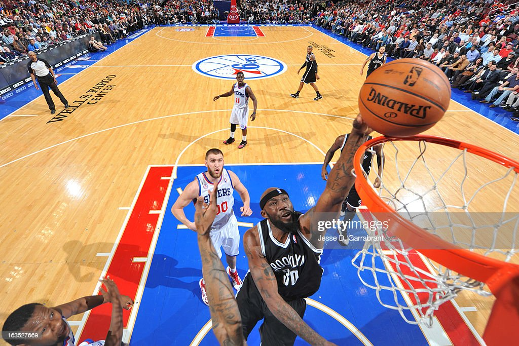 <a gi-track='captionPersonalityLinkClicked' href=/galleries/search?phrase=Reggie+Evans&family=editorial&specificpeople=202254 ng-click='$event.stopPropagation()'>Reggie Evans</a> #30 of the Brooklyn Nets shoots a layup against the Philadelphia 76ers at the Wells Fargo Center on March 11, 2013 in Philadelphia, Pennsylvania.
