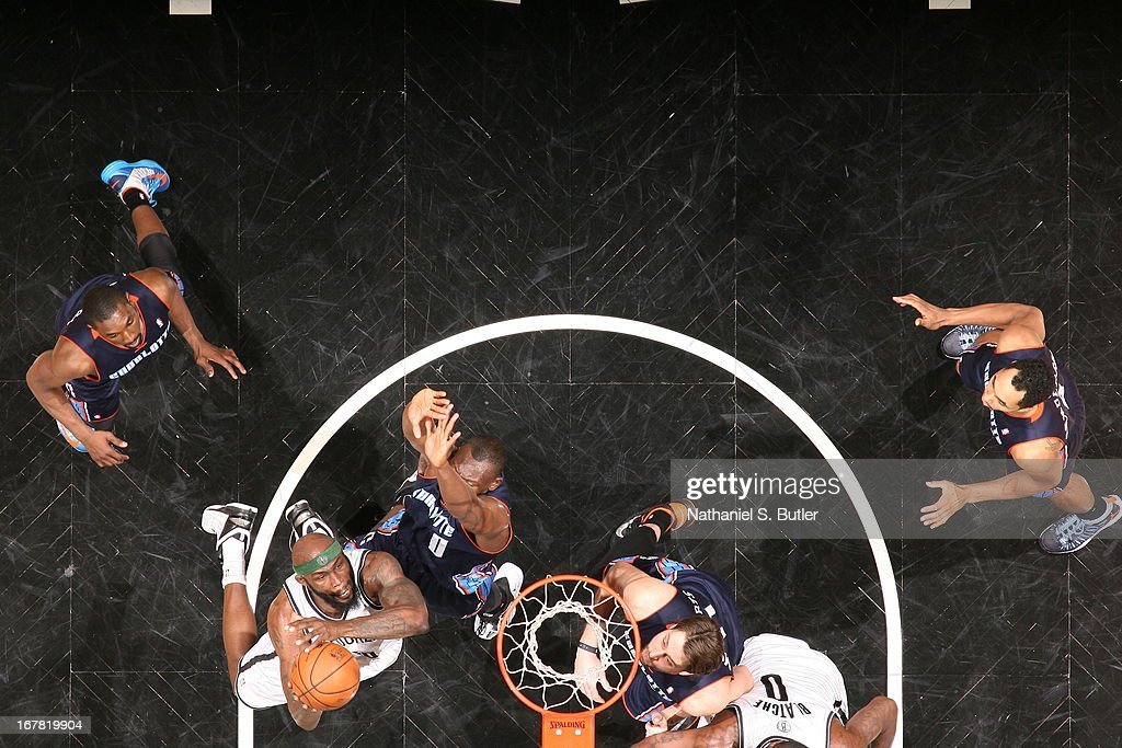 <a gi-track='captionPersonalityLinkClicked' href=/galleries/search?phrase=Reggie+Evans&family=editorial&specificpeople=202254 ng-click='$event.stopPropagation()'>Reggie Evans</a> #30 of the Brooklyn Nets shoots against <a gi-track='captionPersonalityLinkClicked' href=/galleries/search?phrase=Bismack+Biyombo&family=editorial&specificpeople=7640443 ng-click='$event.stopPropagation()'>Bismack Biyombo</a> #0 of the Charlotte Bobcats on April 6, 2013 at the Barclays Center in the Brooklyn borough of New York City.