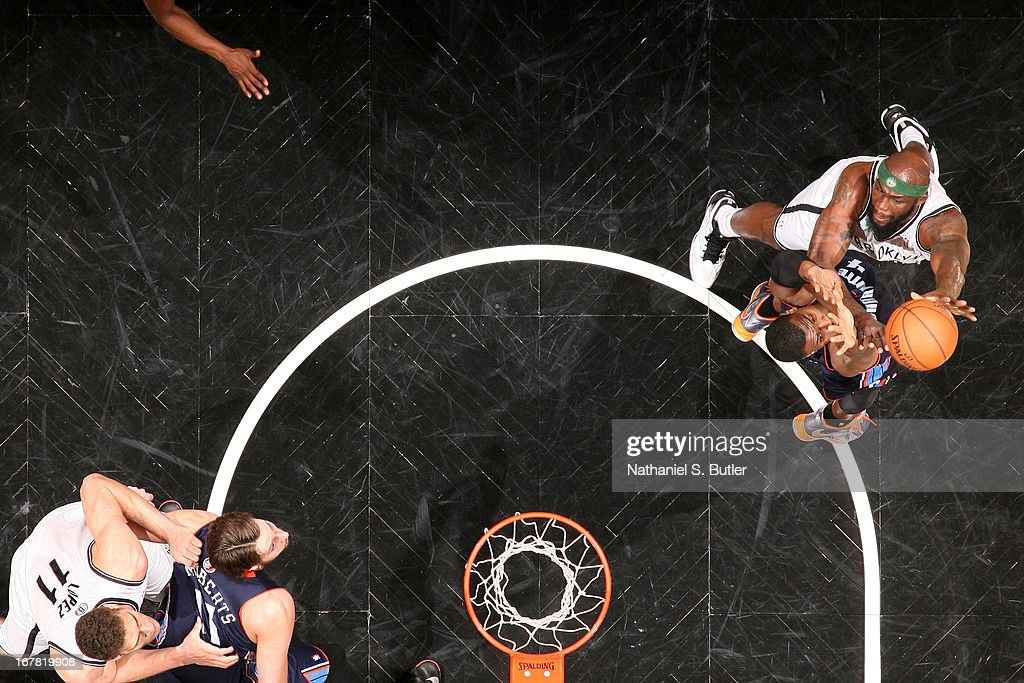 <a gi-track='captionPersonalityLinkClicked' href=/galleries/search?phrase=Reggie+Evans&family=editorial&specificpeople=202254 ng-click='$event.stopPropagation()'>Reggie Evans</a> #30 of the Brooklyn Nets shoots against <a gi-track='captionPersonalityLinkClicked' href=/galleries/search?phrase=Jeff+Adrien&family=editorial&specificpeople=727235 ng-click='$event.stopPropagation()'>Jeff Adrien</a> #4 of the Charlotte Bobcats on April 6, 2013 at the Barclays Center in the Brooklyn borough of New York City.