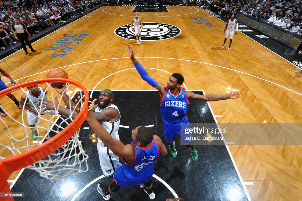 <a gi-track='captionPersonalityLinkClicked' href=/galleries/search?phrase=Reggie+Evans&family=editorial&specificpeople=202254 ng-click='$event.stopPropagation()'>Reggie Evans</a> #30 of the Brooklyn Nets shoots against <a gi-track='captionPersonalityLinkClicked' href=/galleries/search?phrase=Lavoy+Allen&family=editorial&specificpeople=4628334 ng-click='$event.stopPropagation()'>Lavoy Allen</a> #50 of the Philadelphia 76ers on April 9, 2013 at the Barclays Center in Brooklyn, New York.