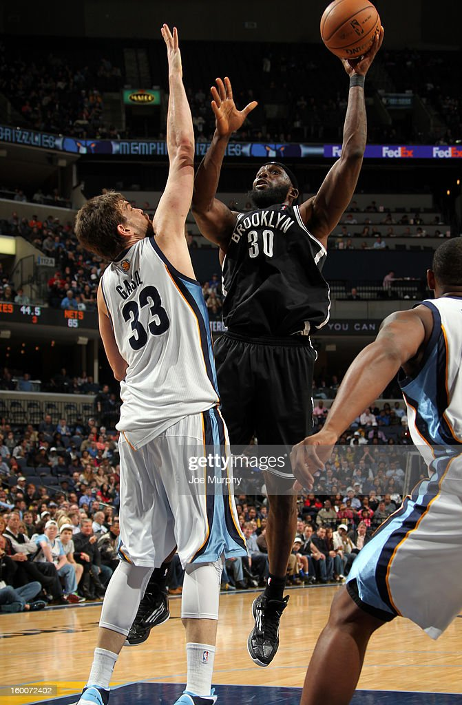 Reggie Evans #30 of the Brooklyn Nets shoots against Marc Gasol #33 of the Memphis Grizzlies on January 25, 2013 at FedExForum in Memphis, Tennessee.