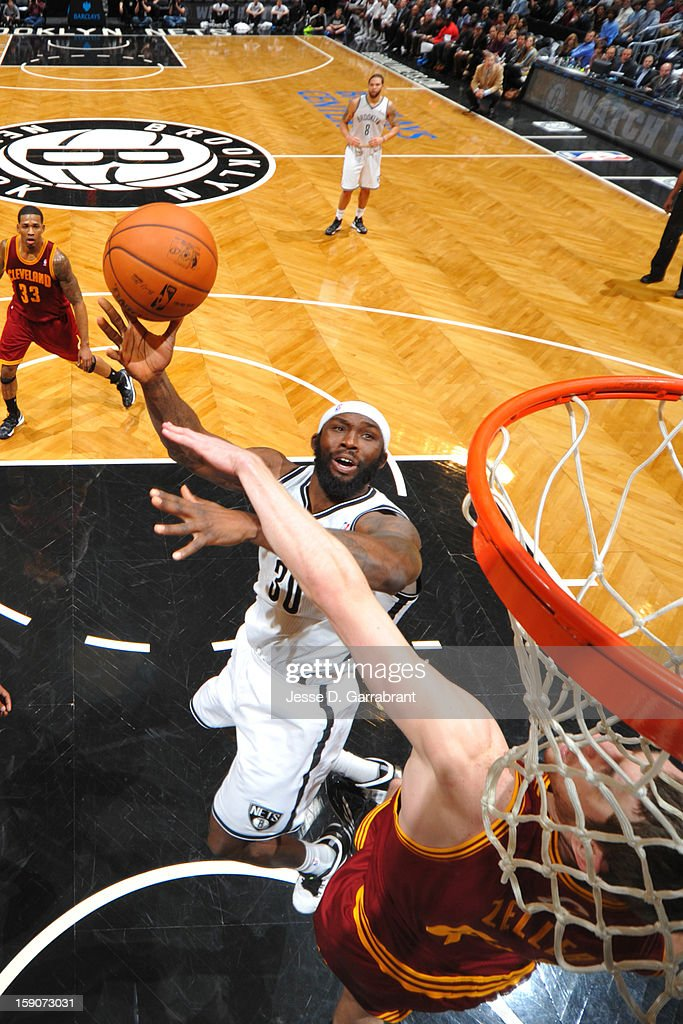 Reggie Evans #30 of the Brooklyn Nets shoots against the Cleveland Cavaliers at the Barclays Center on December 29, 2012 in Brooklyn, New York.