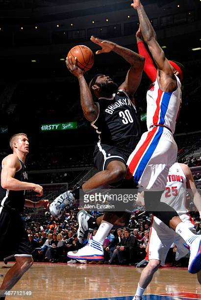 Reggie Evans of the Brooklyn Nets shoots against the Detroit Pistons on February 7 2014 at The Palace of Auburn Hills in Auburn Hills Michigan NOTE...