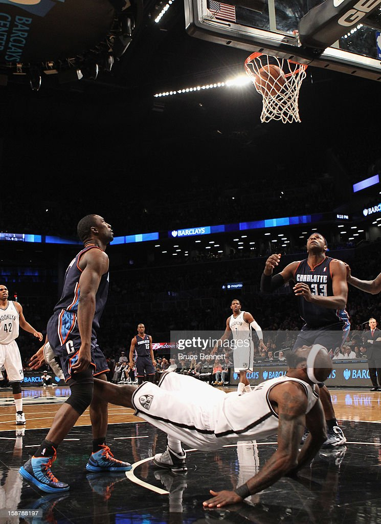 Reggie Evans #30 of the Brooklyn Nets watches the shot by Ben Gordon #8 of the Charlotte Bobcats go in as he takes the foul in the second quarter at the Barclays Center on December 28, 2012 in the Brooklyn borough of New York City.