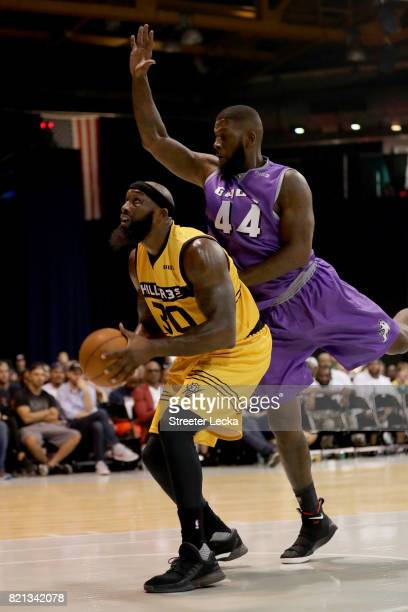 Reggie Evans of the Killer 3s attempts a shot while being guarded by Ivan Johnson of the Ghost Ballers during week five of the BIG3 three on three...