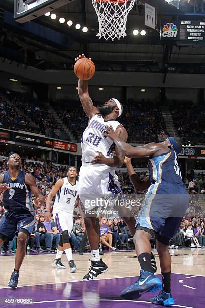 Reggie Evans of the Sacramento Kings grabs a rebound against the Memphis Grizzlies at Sleep Train Arena on November 30 2014 in Sacramento California...