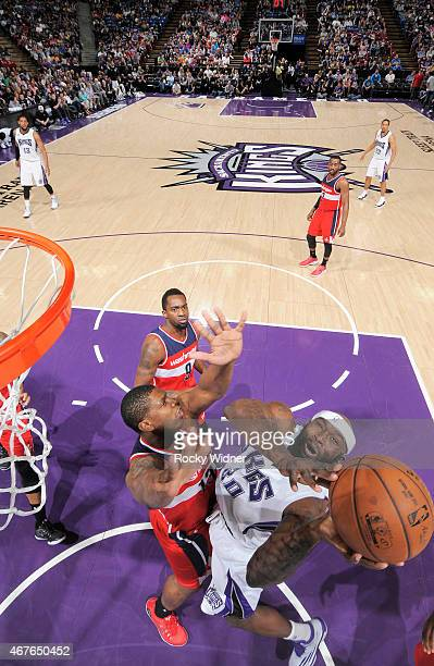 Reggie Evans of the Sacramento Kings puts up a shot against Kevin Seraphin of the Washington Wizards on March 22 2015 at Sleep Train Arena in...