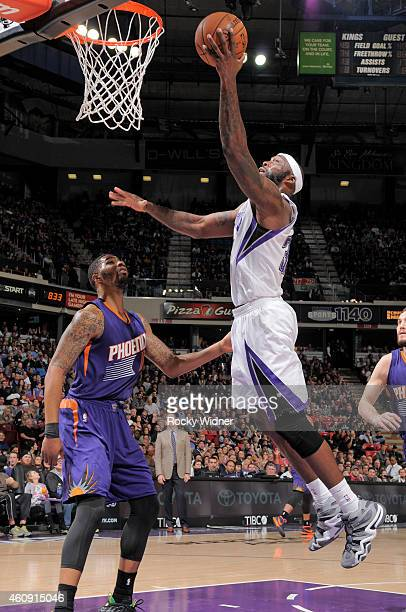 Reggie Evans of the Sacramento Kings shoots a layup against Markieff Morris of the Phoenix Suns on December 26 2014 at Sleep Train Arena in...