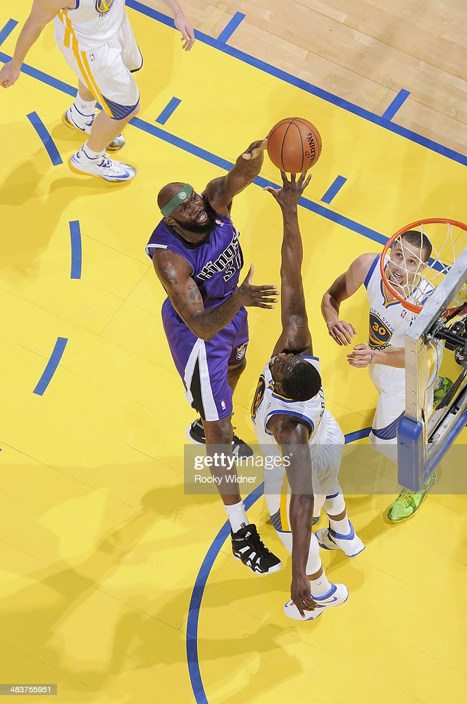 <a gi-track='captionPersonalityLinkClicked' href=/galleries/search?phrase=Reggie+Evans&family=editorial&specificpeople=202254 ng-click='$event.stopPropagation()'>Reggie Evans</a> #30 of the Sacramento Kings shoots against <a gi-track='captionPersonalityLinkClicked' href=/galleries/search?phrase=Draymond+Green&family=editorial&specificpeople=5628054 ng-click='$event.stopPropagation()'>Draymond Green</a> #23 of the Golden State Warriors on April 4, 2014 at Oracle Arena in Oakland, California.