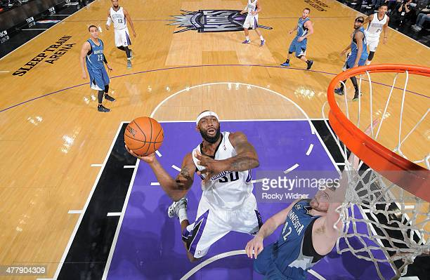 Reggie Evans of the Sacramento Kings shoots against Kevin Love of the Minnesota Timberwolves on March 1 2014 at Sleep Train Arena in Sacramento...