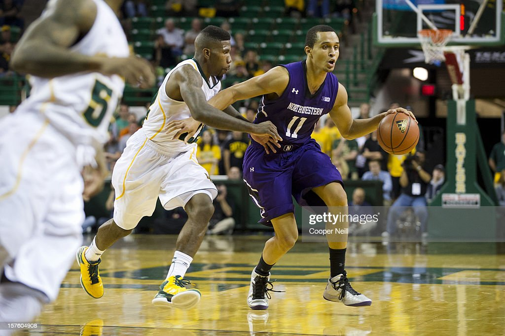 Reggie Hearn #11 of the Northwestern University Wildcats drives to the basket against the Baylor University Bears on December 4, 2012 at the Ferrell Center in Waco, Texas.