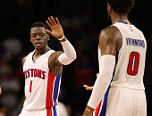 Reggie Jackson and Andre Drummond of the Detroit Pistons celebrate in the fourth quarter while playing the Utah Jazz at the Palace of Auburn Hills on...