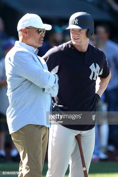 Reggie Jackson and Clint Frazier of the New York Yankees talk before the game against the Seattle Mariners at Safeco Field on July 22 2017 in Seattle...