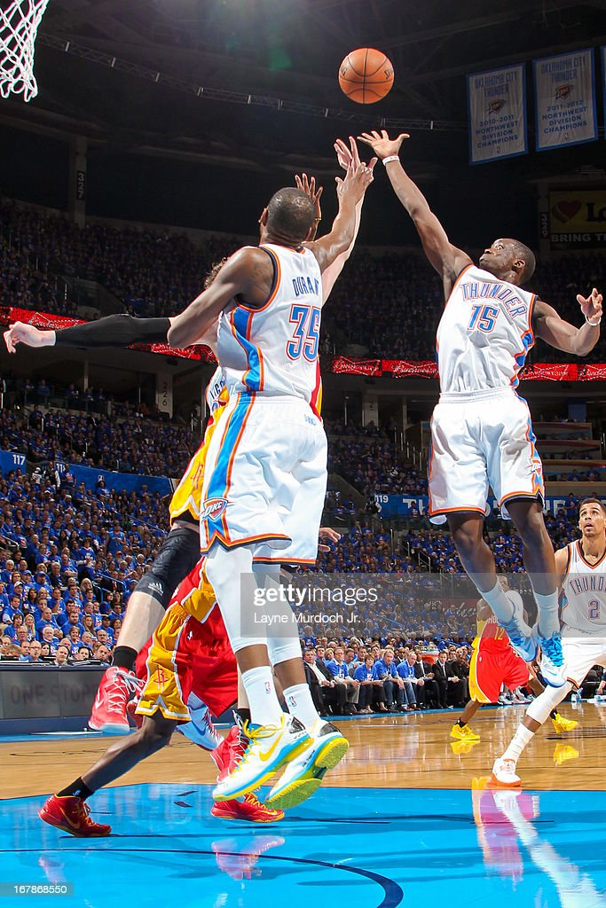 Reggie Jackson #15 and Kevin Durant #35 of the Oklahoma City Thunder reach for a rebound against the Houston Rockets in Game Five of the Western Conference Quarterfinals during the 2013 NBA Playoffs on May 1, 2013 at the Chesapeake Energy Arena in Oklahoma City, Oklahoma.