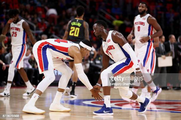 Reggie Jackson and Tobias Harris of the Detroit Pistons celebrate a first half basket while playing the Atlanta Hawks at Little Caesars Arena on...