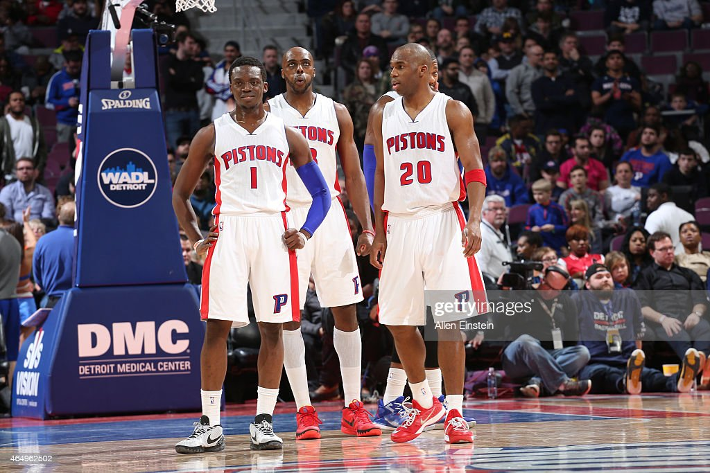 Reggie Jackson Anthony Tolliver and Jodie Meeks of the Detroit Pistons stand on the court against the New York Knicks on February 27 2015 at The...