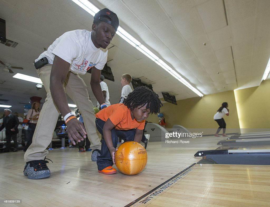 Reggie Jackson #15 joins Russell Westbrook #0 of the Oklahoma City Thunder at his annual Why Not Foundation fundraiser to benefit the Boys and Girls Club at AMC Boulevard Bowl in Edmond, Oklahoma.