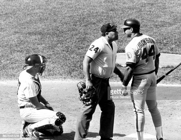 Reggie Jackson of the California Angels argues with umpire Al Clark during an MLB game against the New York Yankees circa 1982 at Yankee Stadium in...