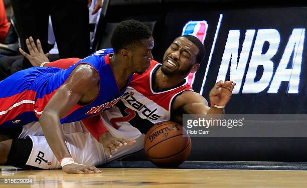 Reggie Jackson of the Detroit Pistons and John Wall of the Washington Wizards go after a loose ball in the second half at Verizon Center on March 14...