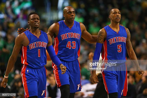 Reggie Jackson of the Detroit Pistons Anthony Tolliver and Kentavious CaldwellPope walk towards the bench during a time out during the fourth quarter...