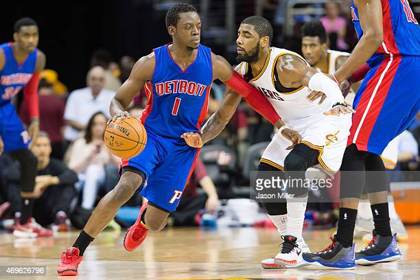 Reggie Jackson of the Detroit Pistons drives around Kyrie Irving of the Cleveland Cavaliers during the first half at Quicken Loans Arena on April 13...