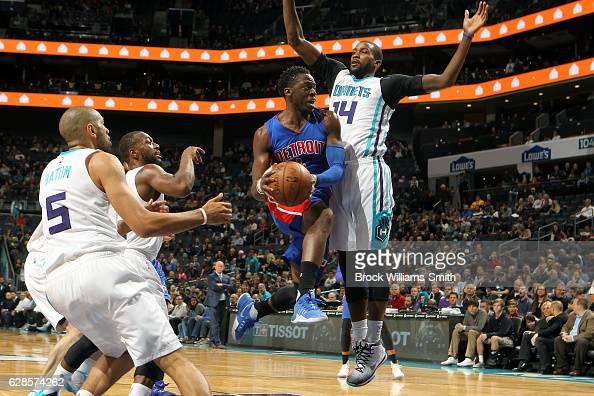 Reggie Jackson of the Detroit Pistons drives to the basket against Michael KiddGilchrist of the Charlotte Hornets on December 7 2016 at Spectrum...