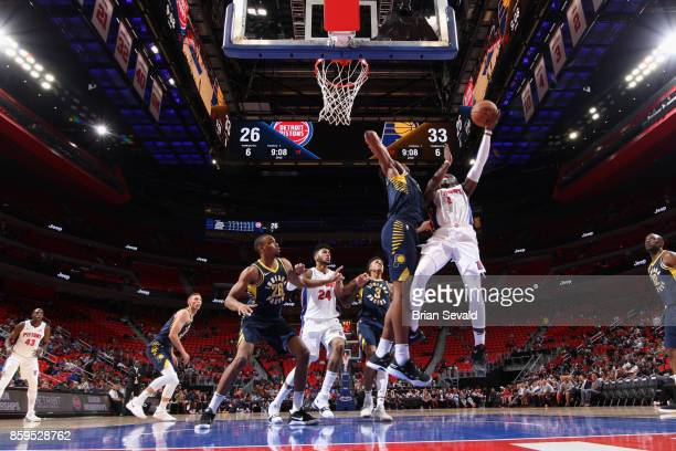 Reggie Jackson of the Detroit Pistons goes to the basket against the Indiana Pacers on October 9 2017 at Little Caesars Arena in Detroit Michigan...