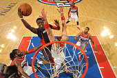 Reggie Jackson of the Detroit Pistons goes up for a shot against the Washington Wizards February 22 2015 at The Palace of Auburn Hills in Auburn...