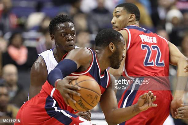 Reggie Jackson of the Detroit Pistons guards John Wall of the Washington Wizards at Verizon Center on December 16 2016 in Washington DC NOTE TO USER...