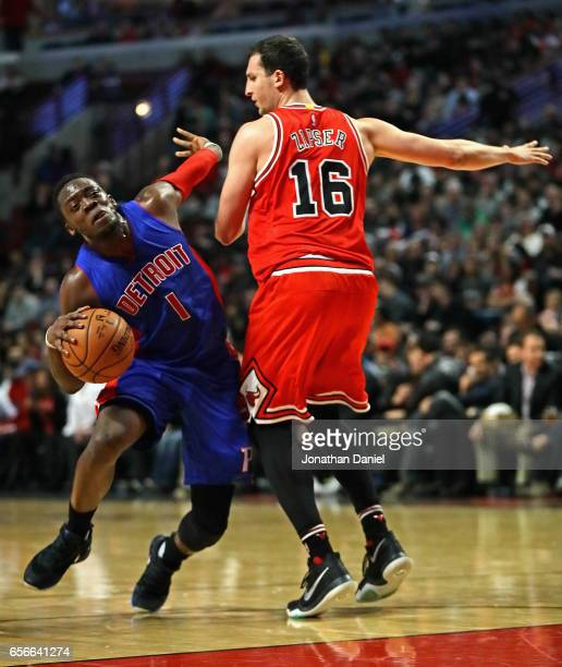 Reggie Jackson of the Detroit Pistons is fouled by Paul Zipser of the Chicago Bulls at the United Center on March 22 2017 in Chicago Illinois NOTE TO...