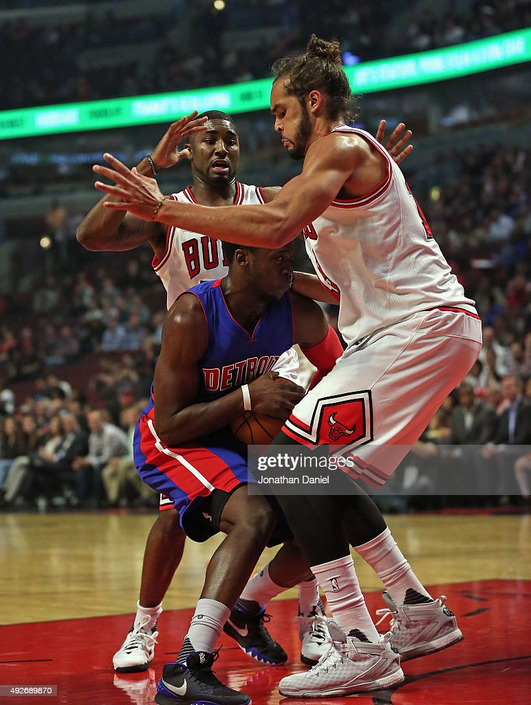 Reggie Jackson #1 of the Detroit Pistons is trapped by Joakim Noah #13 and E'Twaun Moore #55 of the Chicago Bulls during a preseason game at the United Center on October 14, 2015 in Chicago, Illinois. Note to User: User expressly acknowledges and agrees that, by downloading and or using the photograph, User is consenting to the terms and conditions of the Getty Images License Agreement.