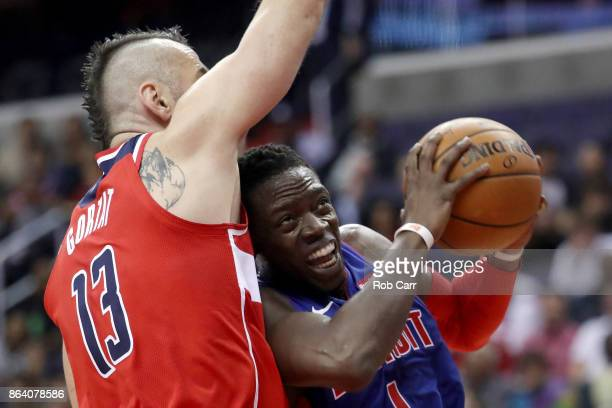 Reggie Jackson of the Detroit Pistons puts up a shot against Marcin Gortat of the Washington Wizards in the first half at Capital One Arena on...