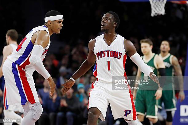 Reggie Jackson of the Detroit Pistons reacts to a three point basket with Tobias Harris during the first half while playing the Milwaukee Bucks at...