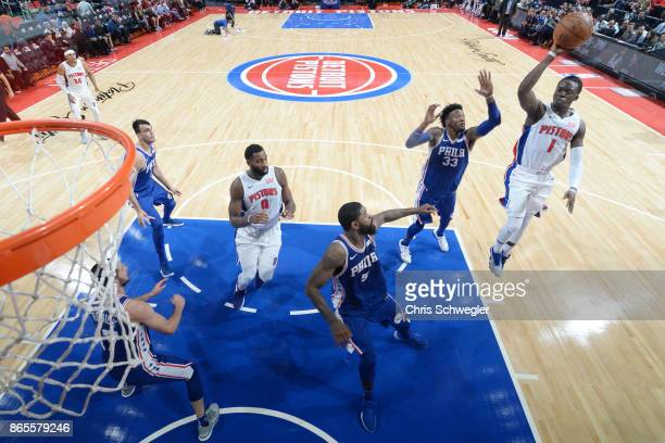 Reggie Jackson of the Detroit Pistons shoots against the Philadelphia 76ers on October 23 2017 at Little Caesars Arena in Detroit Michigan NOTE TO...