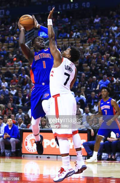 Reggie Jackson of the Detroit Pistons shoots the ball as Kyle Lowry of the Toronto Raptors defends during the first half of an NBA preseason game at...