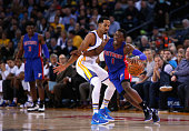 Reggie Jackson of the Detroit Pistons tries to dribble around Shaun Livingston of the Golden State Warriors at ORACLE Arena on November 9 2015 in...