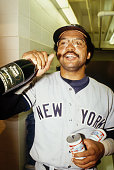 Reggie Jackson of the New York Yankees prepares to down some champagne and beer during the World Series against the Los Angeles Dodgers at Dodger...