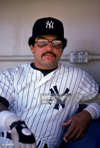 Reggie Jackson of the New York Yankees looks on as he sits in the dougout bench in 1980
