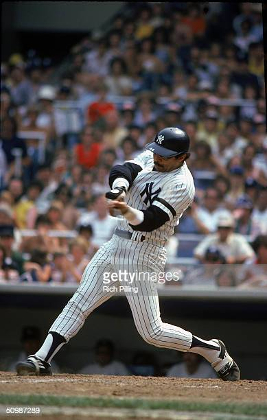 Reggie Jackson of the New York Yankees takes a swing during a game in 1980 at Yankee Stadium in Bronx New York