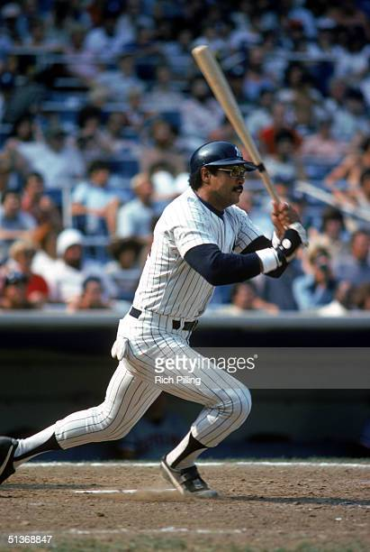 Reggie Jackson of the New York Yankees watches the flight of the ball as he runs out of the batters box during a game in 1978 at Yankee Stadium in...
